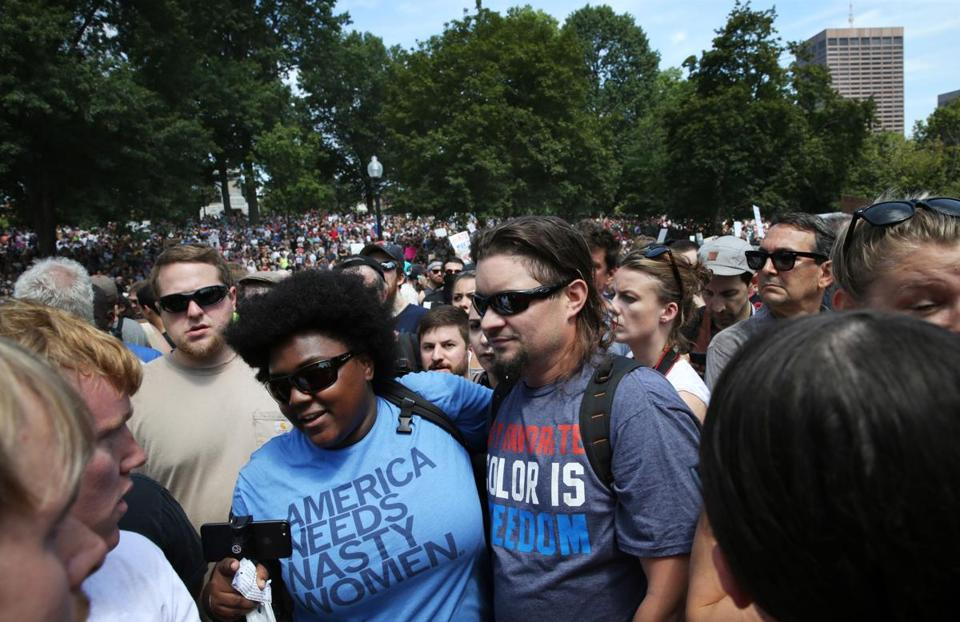 Boston, MA- August 19, 2017: Imani Williams helping Trump supporter through the crowd at the Boston Common, Boston, MA on August 19, 2017. Thousands of protesters are expected to flood downtown Boston Saturday, with the ÒBoston Free SpeechÓ rally on Boston Common likely surrounded by several different counter-actions. (CRAIG F. WALKER/GLOBE STAFF) section: metro reporter: